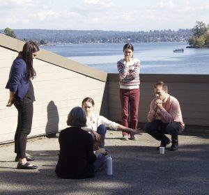 participants deliberate on sunny patio