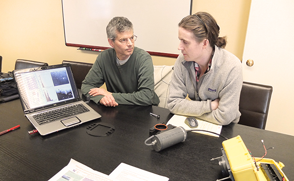 Daniel Grünbaum and graduate student Owen Coyle.
