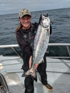 Marina holding a chinook. Photo courtesy of the City of Westport.