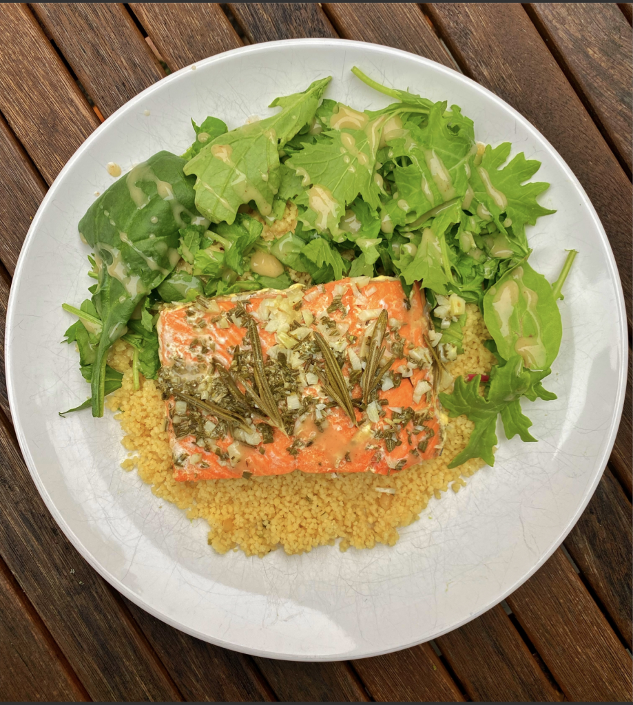 Rosemary salmon paired with couscous and mixed green salad