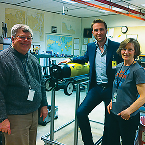 Chadsey talks ocean chemistry with Philippe Cousteau, Jr. (center) and NOAA's Dick Feely.